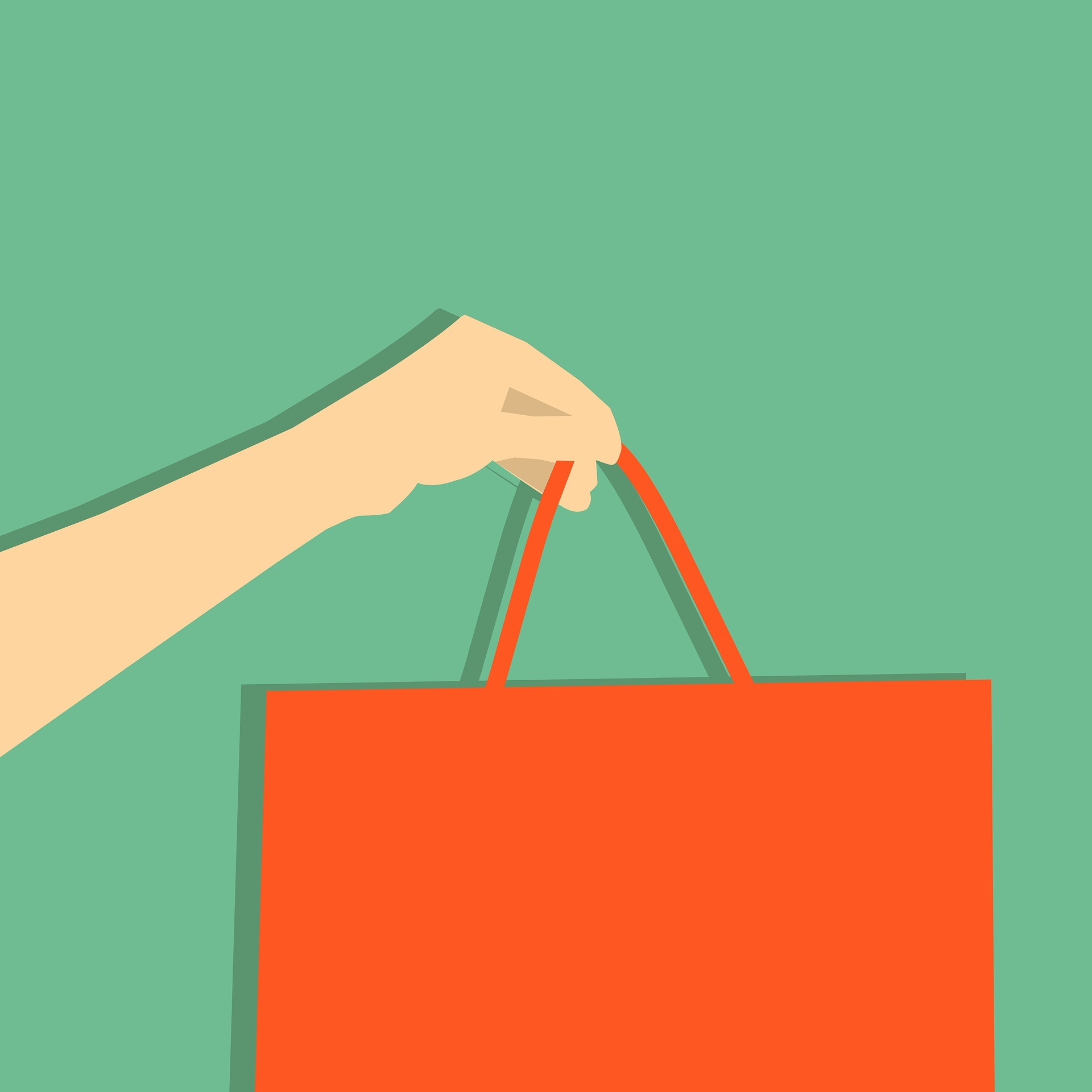 A hand holding a shopping bag