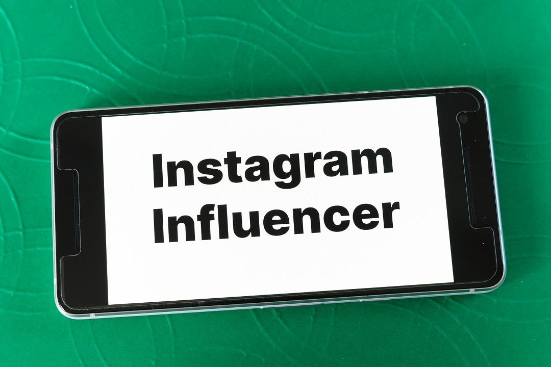 "Smartphone showing words, ""Instagram Influencer"""