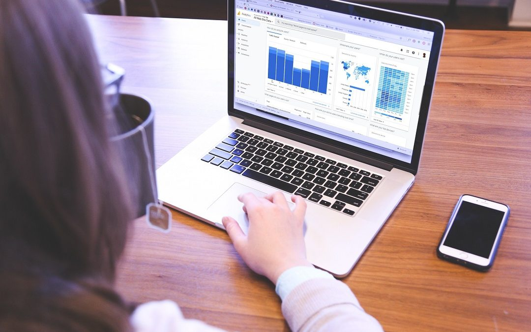 A woman checking statistics on a computer